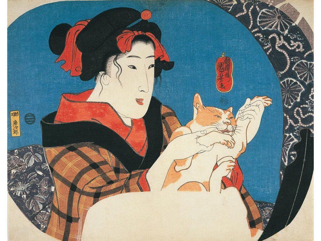 猫と遊ぶ娘